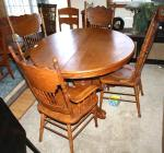 100% oak table and 4 chairs   Round table has...
